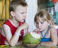 kids drinking a coconut
