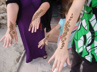 mum and kids arms with henna on it