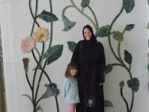 mother and daughter in front of mural at Grand Mosque Abu Dhabi