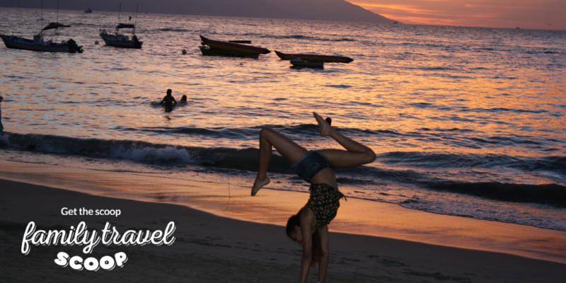 Teenager doing gymastics on the beach in Puerto Vallarta