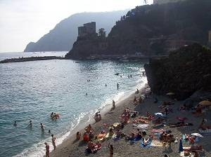 families on the beach in cinque terre