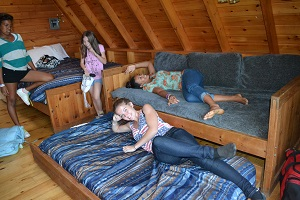 kids in log cabin