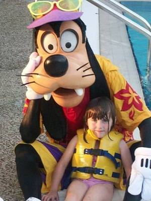 child at Disney Hong Kong with Goofy