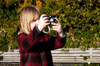 child taking a photo