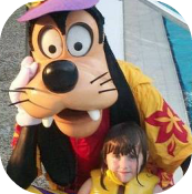 child with goofy at the Disney pool