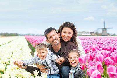 family in the Netherlands with tulips