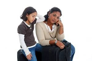 tired mother and daughter traveling