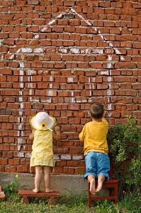 children painting a house