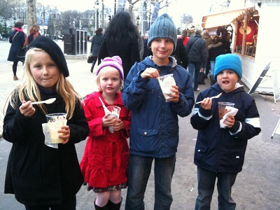 kids enjoying icream and chocolate in paris