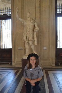 girl in front of statue on the louvre