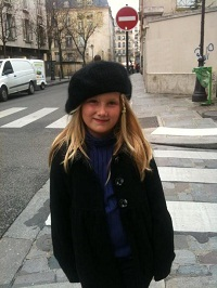 girl wearing berret on paris street
