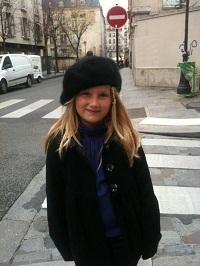 girl wearing berret on paris street