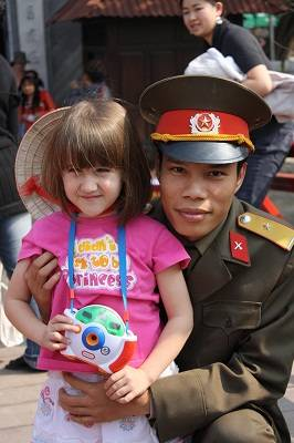 tourist girl in Vietnam with police officer
