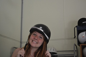 teen with riding hat