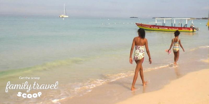 kids walking along beach in Negril Jamaica