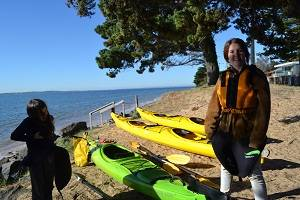 two girls getting read to go kayaking