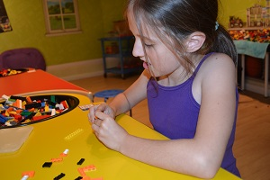 girl making lego