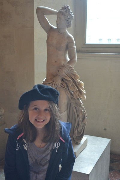 girl in a beret at the Louvre, Paris