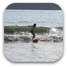 surfing child in costa rica