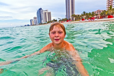 boy in ocean at Miami