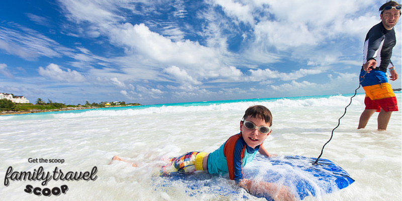 Father & son boogie boarding in Nassau