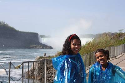 children in front on niagara fall