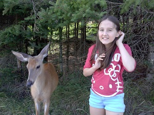 girl with a deer at parc omega