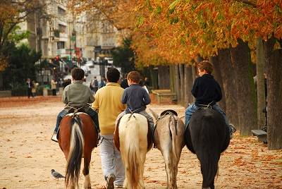 Children riding ponies in Jardins du Luxembourg Luxembourg gardens in Paris France