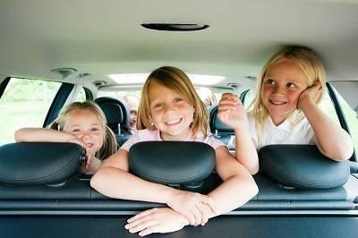 3 girls in a car on a road trip