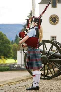 Scottish girl playing bagpipes
