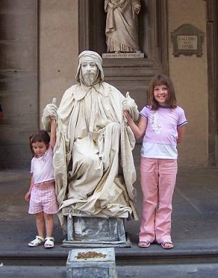 Kids with a love statue in Florence, Italy
