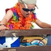 boy packing a suitcase