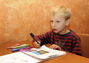 boy completing a travel journal
