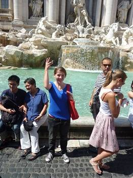 teen throwing a coin in the Trevi Fountain, Rome