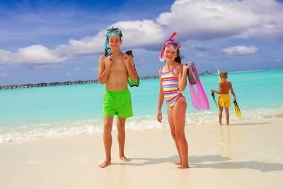 kids on a beach in Fiji