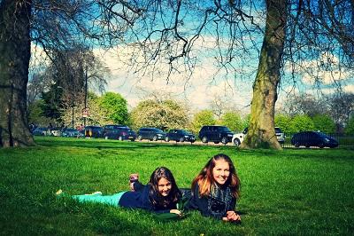 girls on the grass of kensington garden