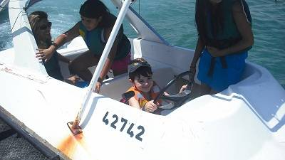 child in a speed boat eilat