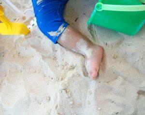 baby's leg on a beach