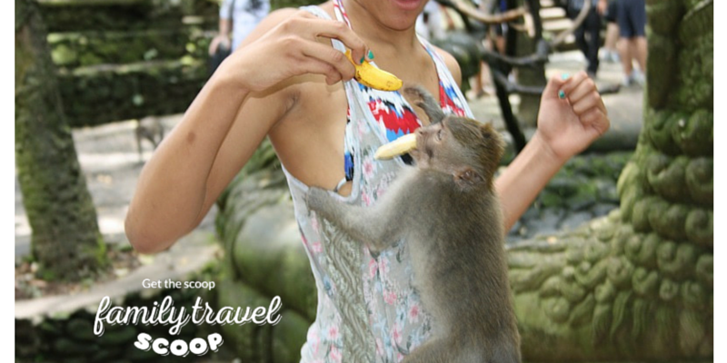 Girl feeding monkey in Bali