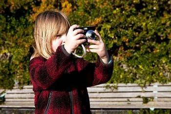 child taking a photo