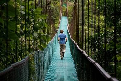 teen boy on bridge in costa ric