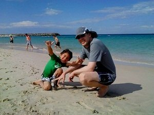 father and son at cottesloe beac