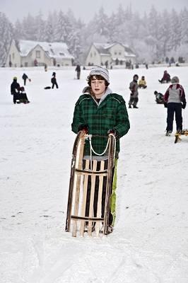 boy toboganning in Germany