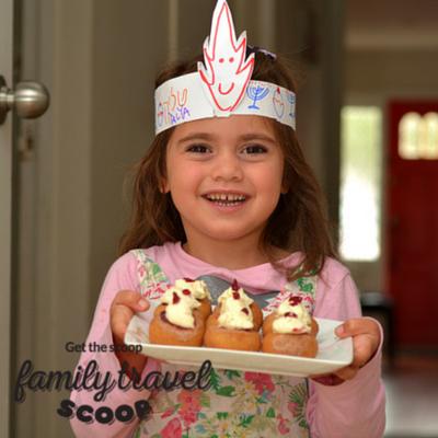 child with Israeli cakes