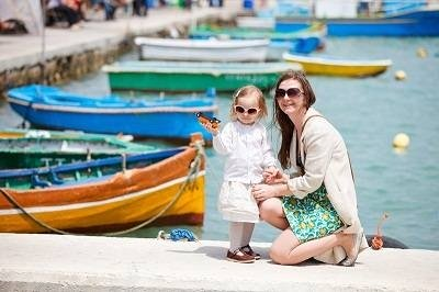 mother and daughter at the Malta harbor