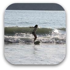 surfing child in costa rica
