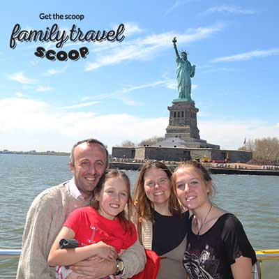 family near statue of liberty