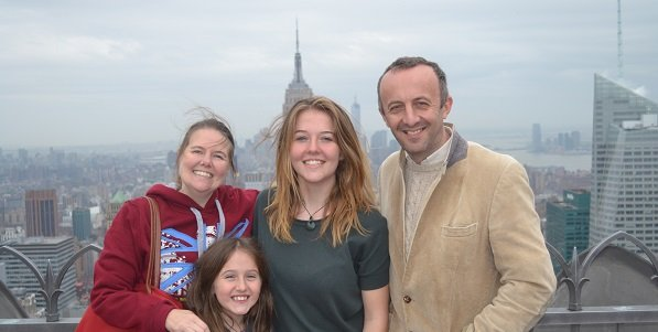 family on top of the rock