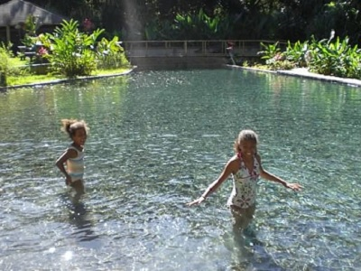Children playing in natural pool in YS Falls